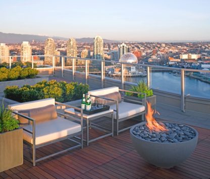 "Solus Hemi 36"" fire pit in cinder colour on roof deck overlooking Vancouver skyline"