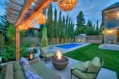 Solus hemi fire it in back garden with pool and glowing lanterns at night (truffle colour)
