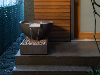 Scupper with box self-contained water feature on doorstep