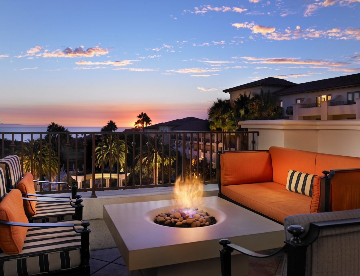 Solus firepit shown lit outside at monarch beach california